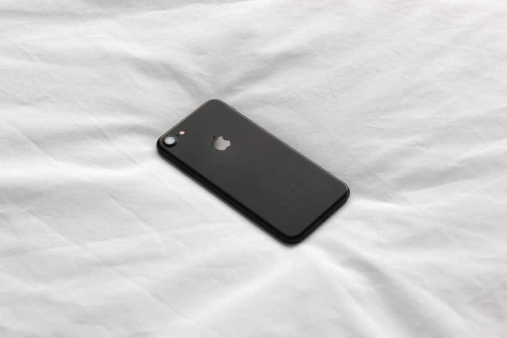 iPhone on bed